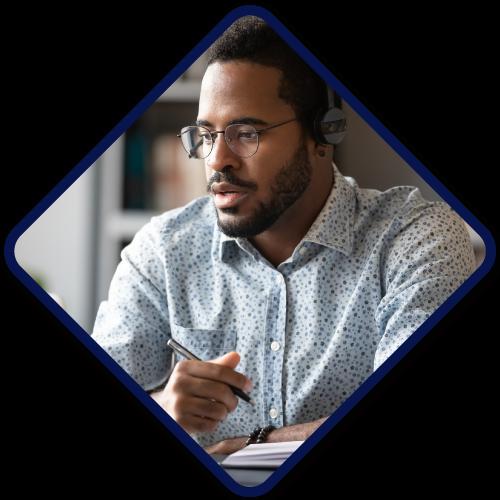 African American man attending online webinar