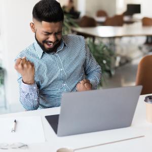 Indian man ecstatic watching online webinar